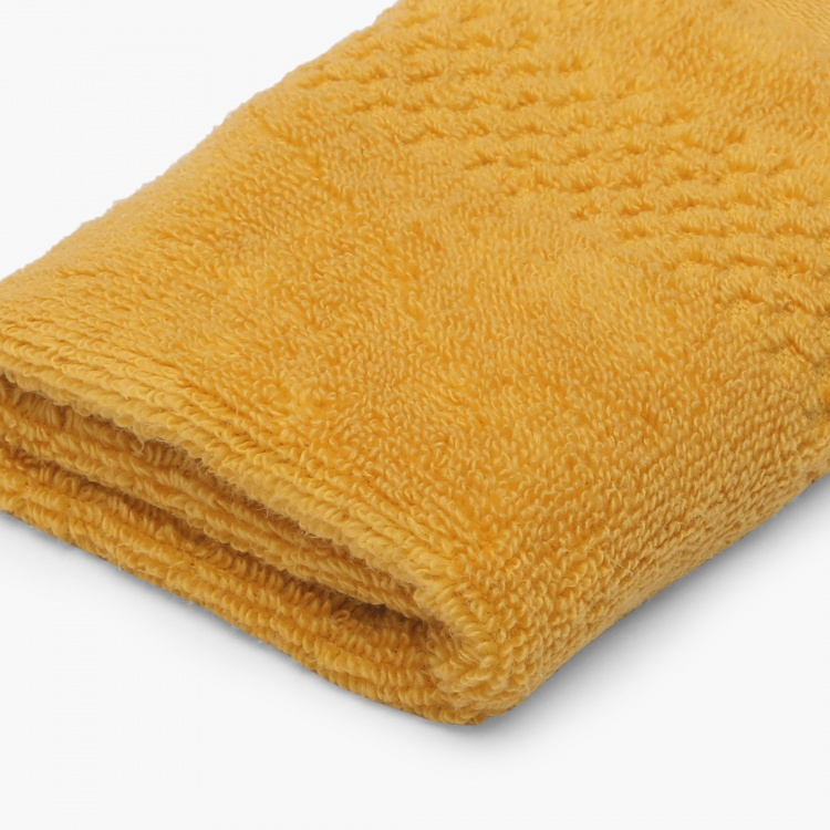 SPACES Solid Textured Face Towel
